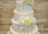 5 tier wedding cake with sugar flowers, pearls and edible lace £650 (for standard round tiers)