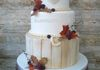 Wood effect wedding cake with autumn leaves from £375