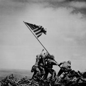 raising american flag in war