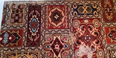 Click on this image for photos and information on our repairs to carpets & rugs damaged by moths...