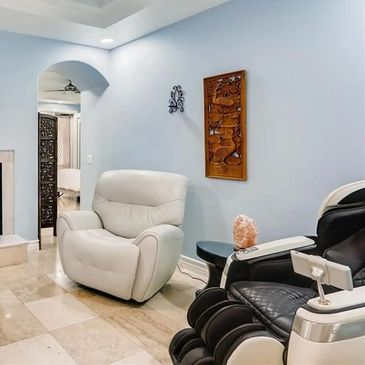 The hypnosis client office area w oversized reclining chair, and a luxury upgraded massage chair