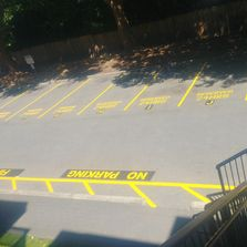 Parking lot painting.  Line Striping. Custom Stencils.