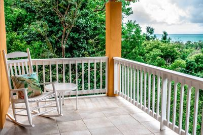 Relax on the covered veranda with your morning coffee or refreshing drink after a day at the beach.