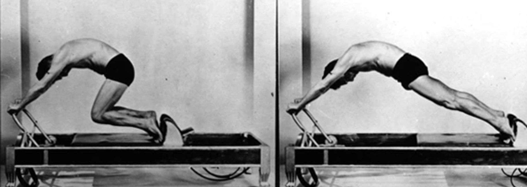 Joseph Pilates performing knee stretches.