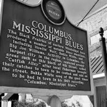 Photo of a Columbus Mississippi Blues Trail historical marker located downtown in the Friendly City near  Catfish Alley, a central meeting and business district for the Columbus African-American Community in the late nineteenth and early twentieth centuries.