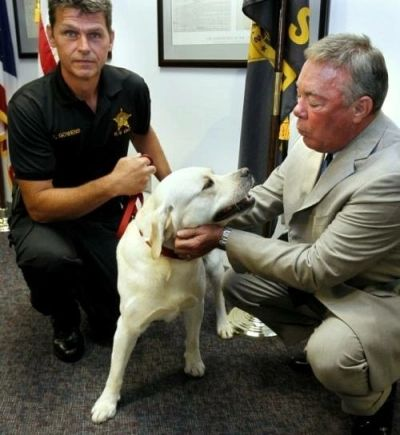 "Detective Gowens and Summit County Sheriff Drew Alexander with Gowens's K9 Labrador Retriever ""Lou"""