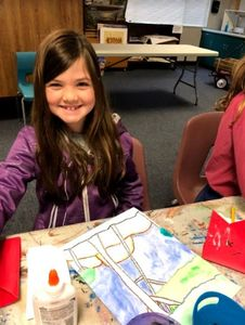 Fourth graders at Lake Forest Elementary work on Emily Carr landscapes using chalk pastels.