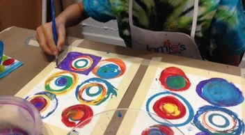 Student's working on a painting inspired by Wassily Kandinsky.