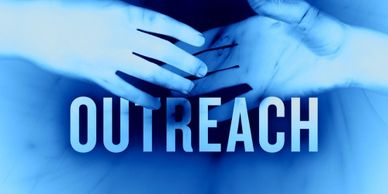 two hands reach toward each other with the word outreach over them blue