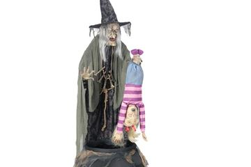 Brew stew witch animated prop with cauldron, flailing child and fog machine.