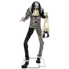animated clown prop in black and white striped clown suit with stringy black hair halloween decor.