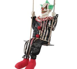 Animated Halloween prop clown swinging on a swing.