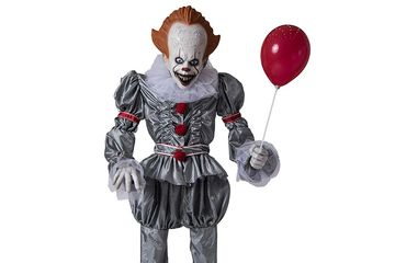 life size Pennywise IT the Clown animated prop with red balloon.