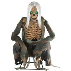 crouching skeleton halloween animated prop with ragged clothing and long white hair and glowing eyes
