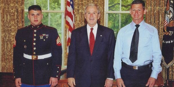 Photo as a Marine with President George W. Bush