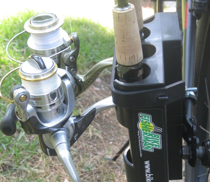 INTRODUCING Bike Fisherman fishing rod holder shown mounted on a bicycle with fishing poles secured
