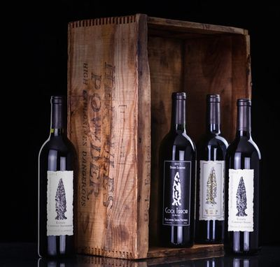 4 bottles of Red Wine in an old antique box