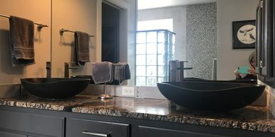 "<img src=""Master_Bath.jpg"" alt=""Masculine master bath with lava vessel sinks and mosaic tile"">"
