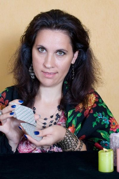 Maria, a psychic reader with tarot cards.
