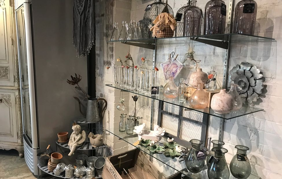 Glass shelves with grey & pink glass vases, ceramic bird trays, clear beakers