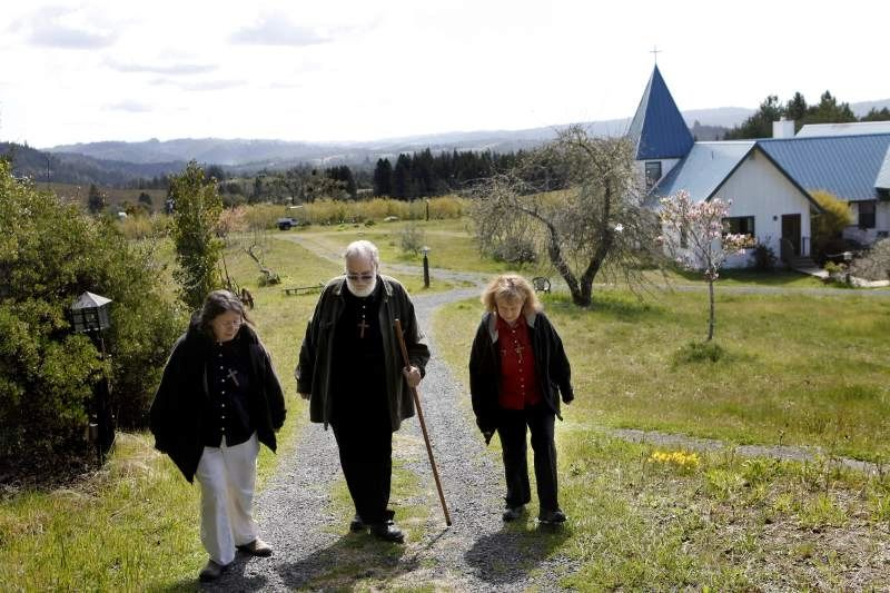 Starcross Founders, Sister Marti, Brother Toby, and Sister Julie walking to the chapel.