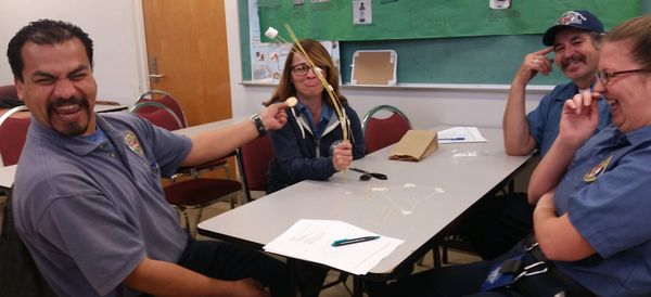 Staff at the City of Los Angeles playing the 'Marshmallow Challenge' in a team-building workshop.