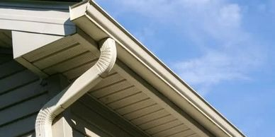 Our roofing company installs siding and gutters