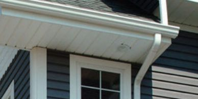 white Gutter soffit and downspout on blue home