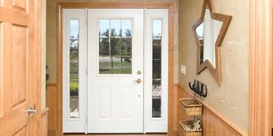 Entry Doors can be simple and elegant. Add sidelites for added style and curb appeal.