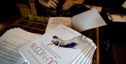 signing copies of You-nicorn