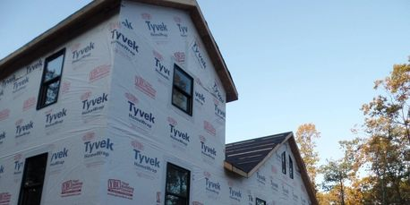 A house wrap is a moisture barrier that protects the wood structure of the home from water damage an