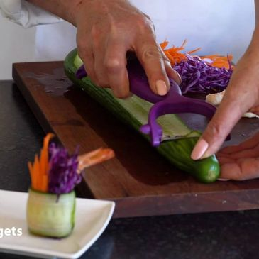 Slicing cucumber for sushi rolls with our Julienne Peeler.
