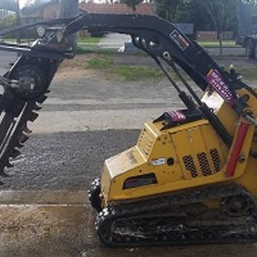 Trackers Skid steer Trencher Machine ideal for trenching up tom 900 deep and 150 wide. Very sturdy Vermeer S450TX machine with other attachments. Easy to operate stand up console