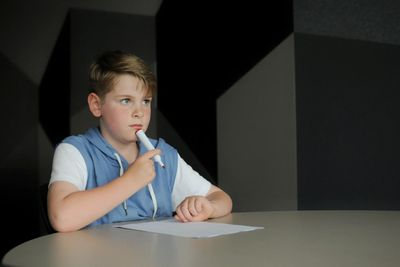 A child sits at a table for learning disability testing.