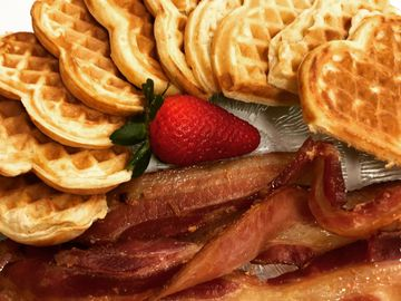 Our waffles are served with real bacon and whipped cream.