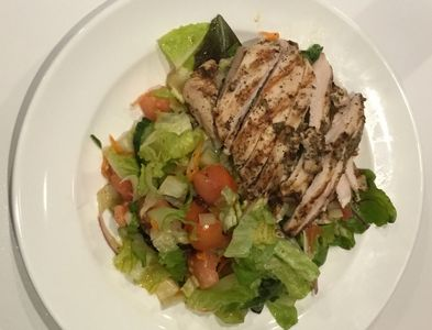 Marinated Grilled chicken with salad.