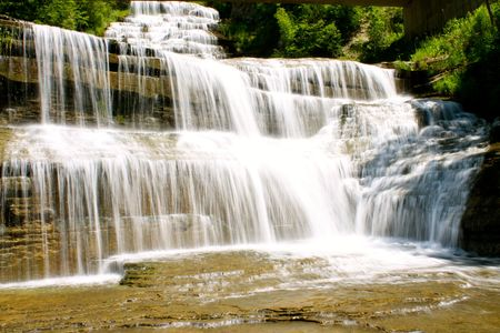 A waterfall that descends approximately 15 feet and is about 30 feet wide. There is a level base.