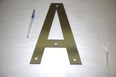 Fabricated stainless steel letter