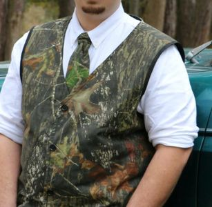Custom made vest with hidden gun pockets.