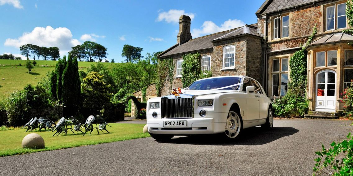 Rolls Royce Phantom Land Rover Defender Wedding car for hire in Devon Limo Hire Devon