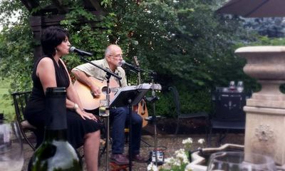 Jim Anderson and Denise Geisler aka Jim & Denise, performing at a summer venue.