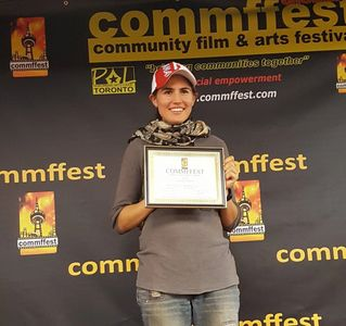 Nicole Zwiren, director of Behind the Fear, receiving an award at Commffest in Toronto, Canada.
