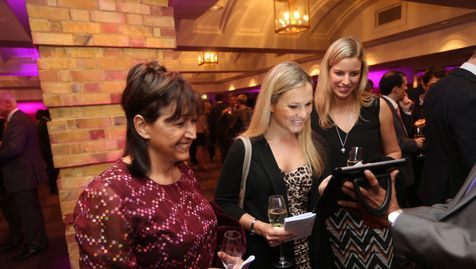 Guests using fotowales iPad system to share live photographs at an event in London on social media