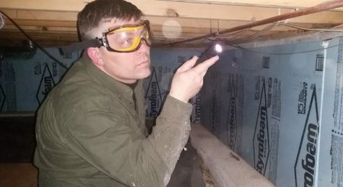 Home Inspector Perry Stafford doing a Home Inspection in Roscommon County.