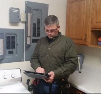 Home Inspector Perry Stafford doing a Home Inspection in Prudenville.