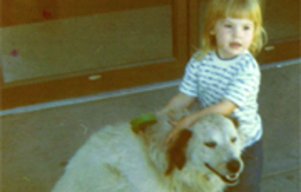 photograph of lisa as a small child with a dog