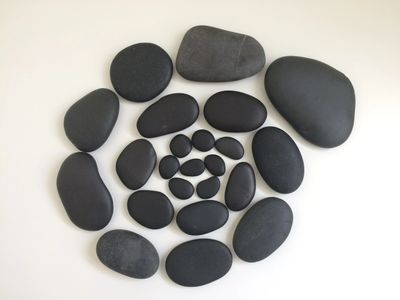 Spiral of smooth, basalt stones used during Hot Stones Reflexology