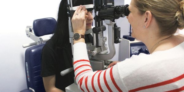 Dr. Ivor-Smith with a patient during a medical eye exam