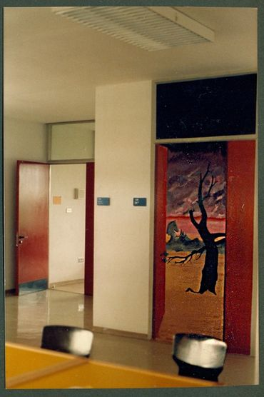 Another mural door showed a surreal landscape. In the background is a real door to a real classroom.