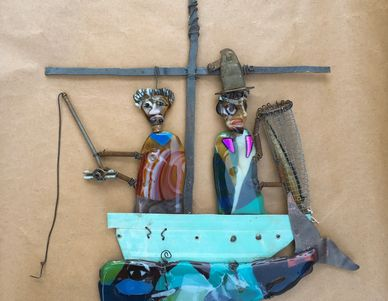 Fused Glass and metal sculpture or two anglers above a whale.